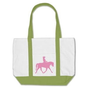 cowgirl riding her horse pink tote bags
